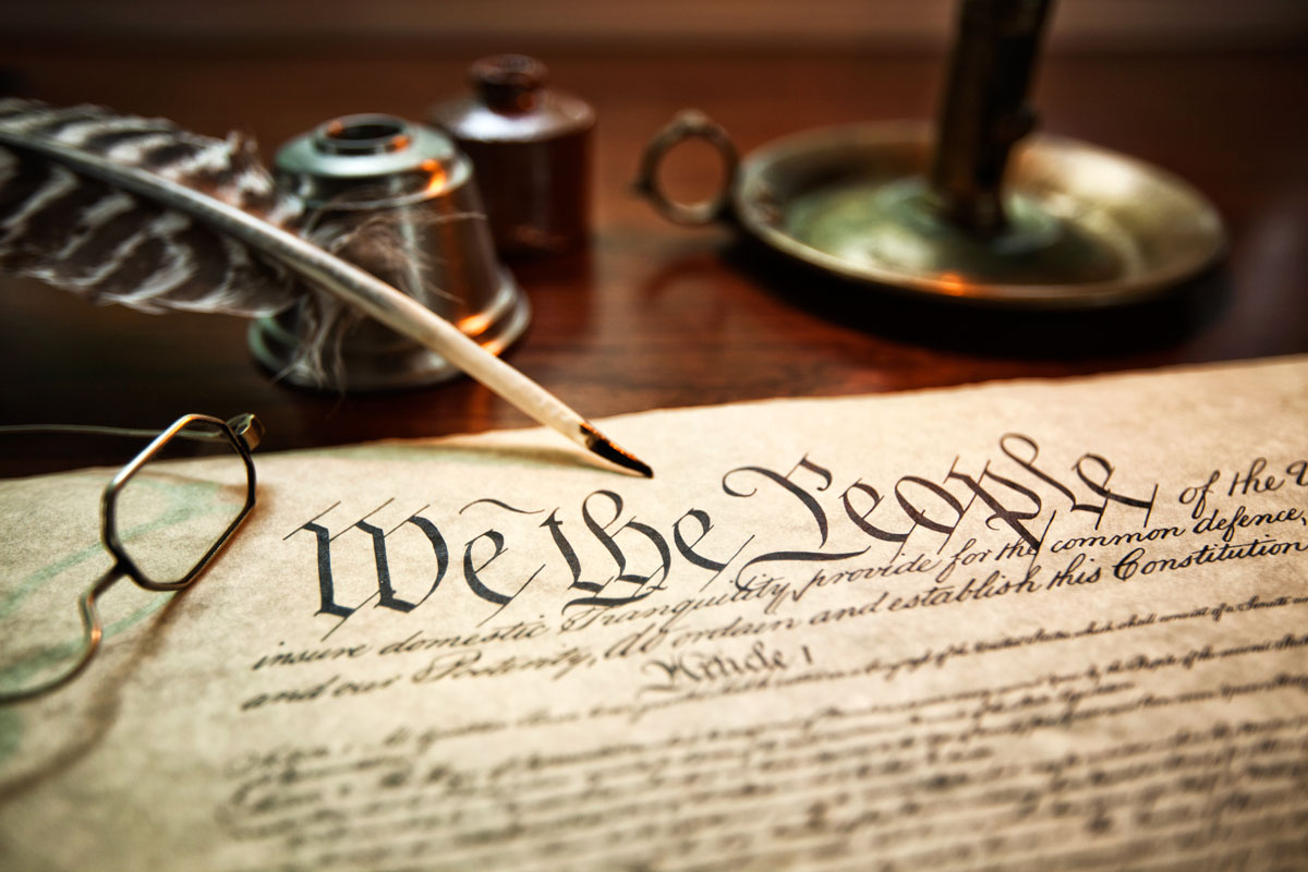 candle-quill-and-inkwell-with-constitution-of-the-USA